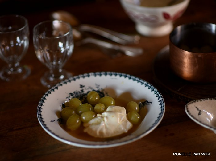 Yogurt marcarpone cream with armagnac flambéed grapes.
